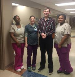 William Bowman with Jackson Hospital staff